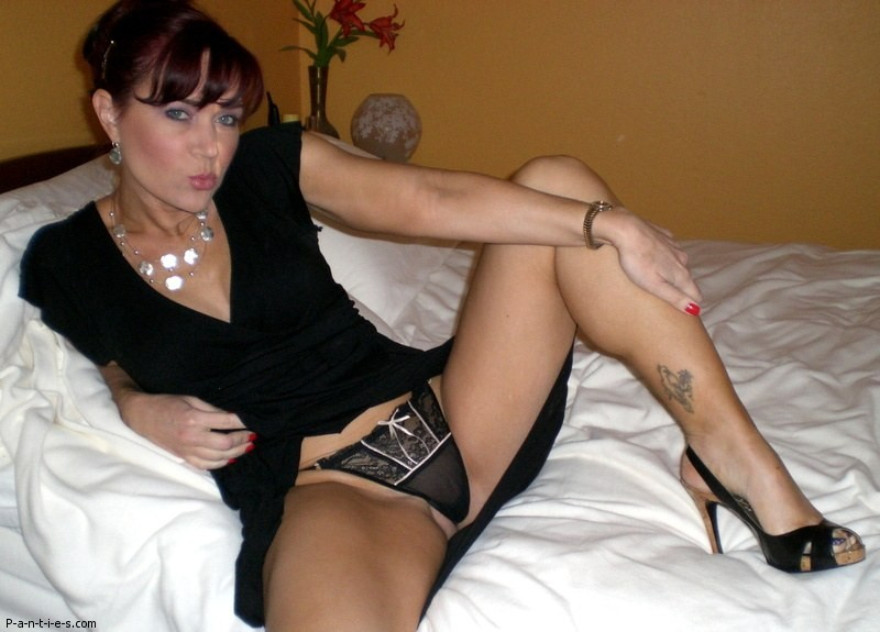 Hot amateur MILF spread her legs to show sheer black panties